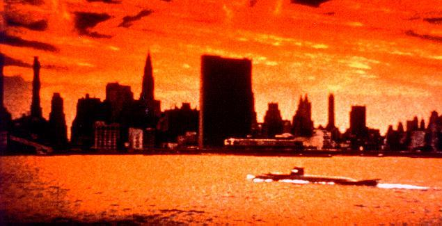Seaview approaches New York under flaming sky.