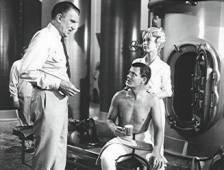 Walter Pidgeon, Robert Sterling and Barbara Eden in the missile room.