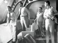 Frankie Avalone, Walter Pidgeon, Peter Lorre and Robert Sterling survey fowled mine.