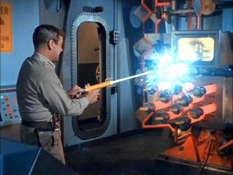 Nelson saves the day by short circuiting the nuclear reactor with a ray-gun blast, thus winning the specious science award for the episode.