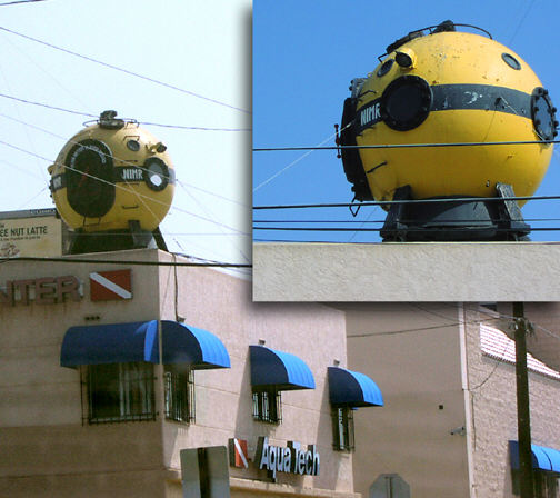 Actual diving bell used in Voyage, now mounted atop AquaTech dive shop in San Diego. Photo taken March, 2003.