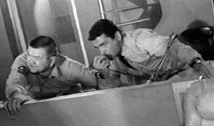 Henry Kulky (Chief Jones) and David Hedison (Captain Crane) in action.